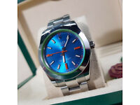 Rolex Milgauss. Silver Bracelet w/ Blue Face, Green Inner Bezel. Rolex Box & Paperwork Included.