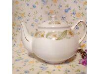 "Vintage ""green sleeves"" tea pot. Excellent condition."