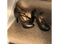 Office size 3 black leather heels