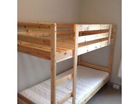 Wooden single bunk beds, nearly new.
