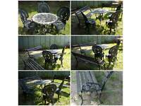 CAST IRON TABLE AND 3 CHAIRS AND 2 BENCHES