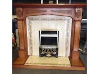 Fire surround complete with tiled hearth and back panel