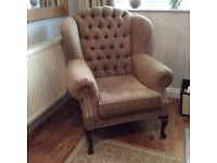 Deep buttoned wing backed armchair like new