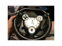 Steering wheel with game on disc