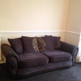 Two three seater sofas