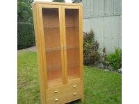 Bookcase with glass door. Very good condition. Light inside.