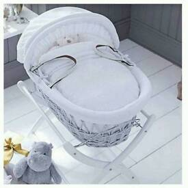 Grey moses basket with white stand