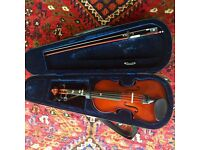 1/2 size violin, bow, chin rest and backpack style carry case