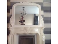 Marble affect fire surround and mirror with fire.