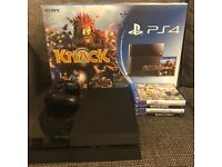 PS4 bundle 500gb console with controller & 4 games