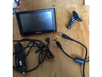 Garmin Sat Nav. Comes with USB lead and cigarette holder lead. Attaches to car windscreen.