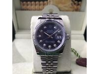 Silver with navy face DateJust Rolex. Complete with box, bag & paperwork