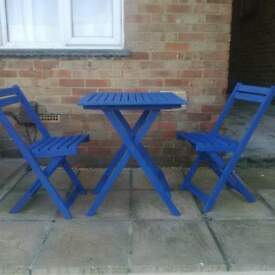 Blue folding table and chairs