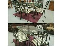 Solid wrought iron dinning table & 6 chairs .can deliver 07808222995