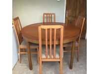Solid round extending table and four chairs