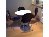 Nearly new Dining table & 4 chairs for sale table is 80 centimetres diameter (31 inches)