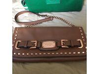Michael Kors tan leather clutch bag