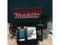 Makita charger, makita drill handle in box for sale