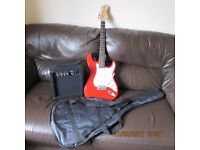 ELECTRIC GUITAR , AMP, CABLES, COVER AND SPARE STRINGS AS NEW £40.