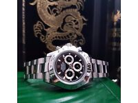 Silver Rolex Daytona with black face comes complete with bag box and papers