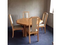 Hexagonal, extending Limed Oak Dining Table and 6 Chairs in very good condition