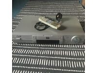 Silver DVD player and remote
