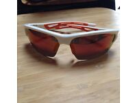 BRAND NEW BOLLE SUNGLASSES with pouch and case. White frames with red /green lens . Cost new £80