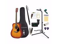 Brand New Yamaha F310 Acoustic Guitar Sunburst with accessory Pack