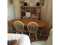 extendable wood dining table and 8 chairs