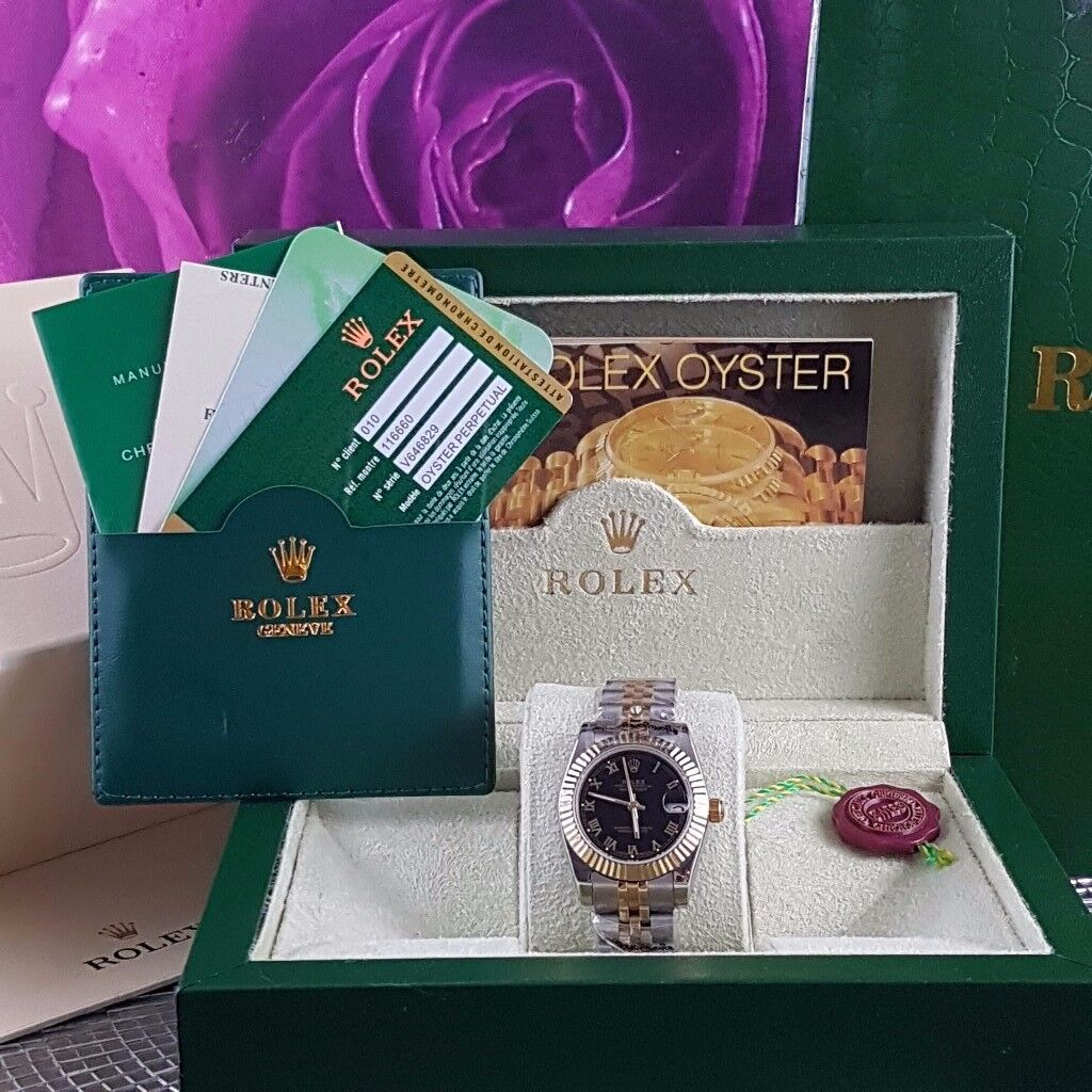 Brand New Twotone Rolex Datejust, Black Face. Roman numetals. Comes Rolex Bagged,Boxed and Paperwork