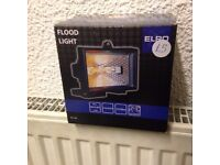 # FLOOD LIGHT TO BE FITTED TO HOUSE OR WALL BRAND NEW IN BOX BARGAIN ONLY £5 FOR QUICK SALE #