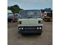 Left hand drive Mitsubishi Canter FE110 2.7 diesel 6 tyres 3.5 Ton truck.