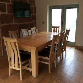 Extendable oak dining table and 8 chairs