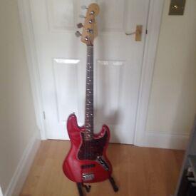 Fender Jazz de-luxe, 2004, 4string bass guitar, Candy apple red. MIM