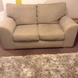 2 seater beige fabric sofa