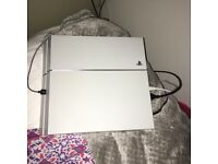 White PlayStation 4 with power cable and controller