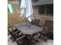 Garden table and 6 chairs and umbrella