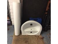 Toilet, large sink, smaller sink, and cistern