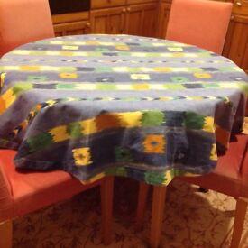 Highly coloured thick linen circular tablecloth