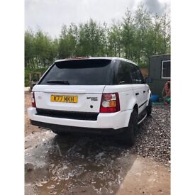 White wrapped Range Rover sport hse
