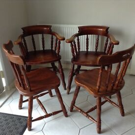 4 good heavy wooden chairs