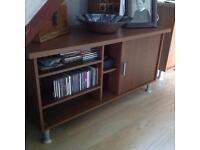 Walnut wood effect TV unit.