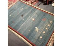 beautiful hand-woven wool rug in very good condition