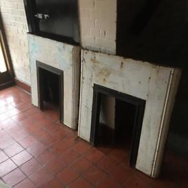 Pair of cast iron fire place surrounds
