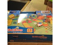 "v-tech toot-toot railway station ""boxed"",garage,fire engine,car transporter, extra road/track"