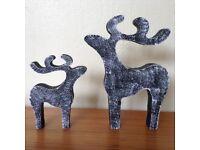 Pair star gazing reindeer christmas decorations black white pebble dash