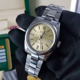 New silver bracelet with yellow dial Rolex oyster with automatic sweeping movement