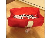 New with tags! Baby Travel Bed/Carrycot. Converts from a shoulder bag to Carrycot or Change Station!