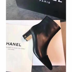Chanel black heel ankle boots