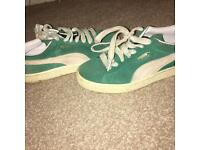 Green puma suede trainers